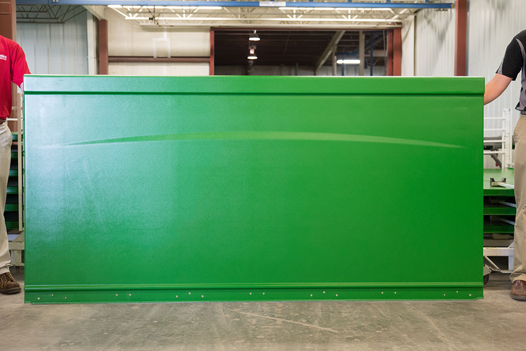 Front side of the grain tank extension panels we produce.
